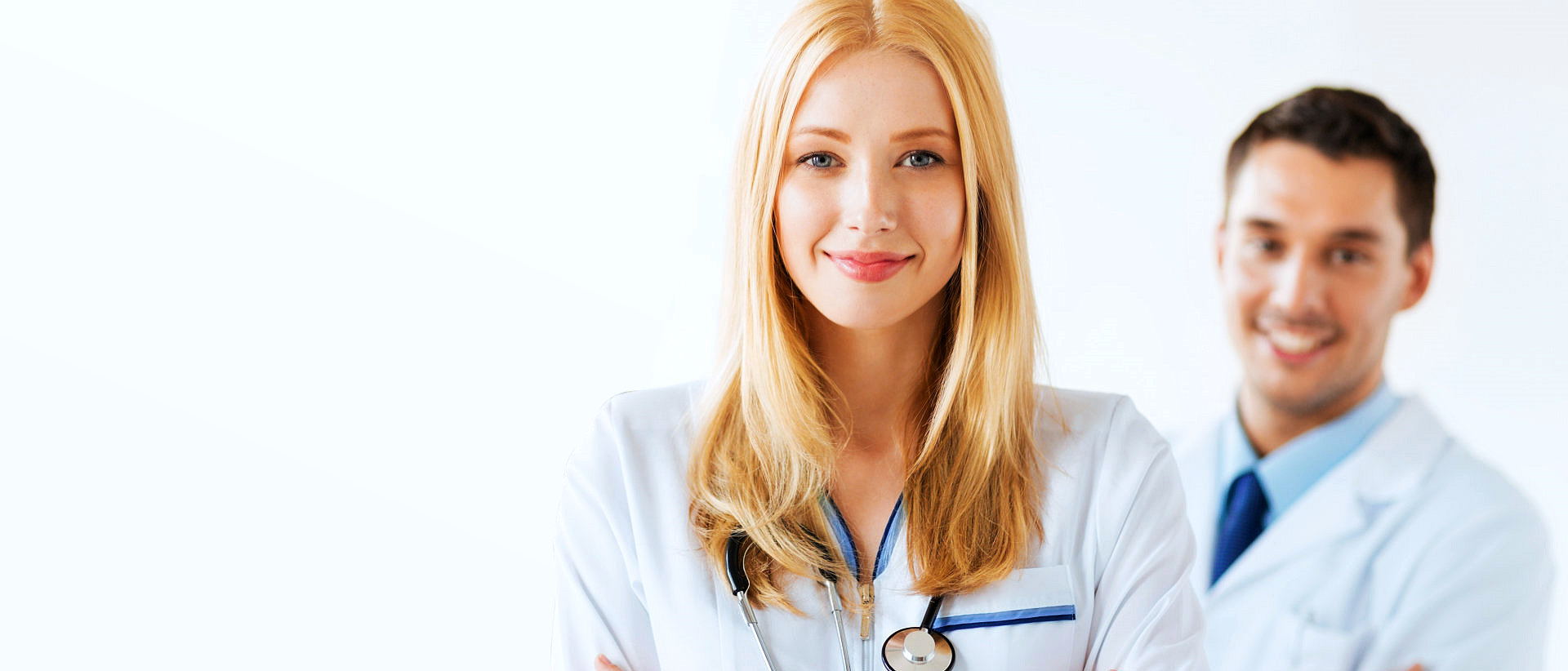 woman with stethoscope smiling