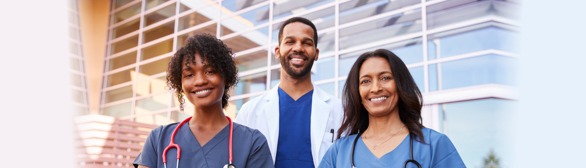 doctor with two nurses smiling